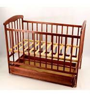 Кроватка детская с маятниковым механизмом