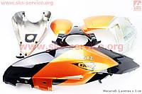 Пластик комплект  9 деталей оранжево- черный   на скутер Zonder - JOKER