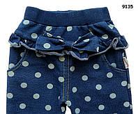 Штаны для девочки. Пояс на широкой резинке, на бедрах украшены оборками и бантом, по бокам карманы.