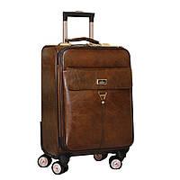 Современный маленький чемодан на колесах.