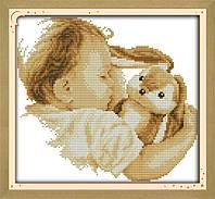 Малыш с игрушкой  Набор для вышивки крестом с печатью на ткани 14ст
