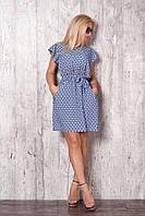 Летнее женское платье темно-синего цвета с коротким рукавом.