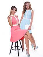 Очаровательное платье модного фасона без рукавов