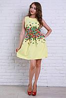 Яркое летнее платье в жёлтом цвете с декоративными складками на талии