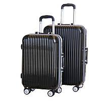 Оригинальный на колесиках пластиковый чемодан двойка.
