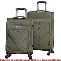 Удобный на колесах чемодан двойка.