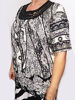 Нарядная женская блуза с черно - белым принтом
