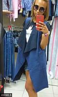 Трикотажный стильный женский жилет свободного фасона с отложным воротником и накладными карманами