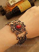 Оригинальный браслет с красным камнем