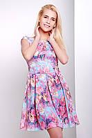 Короткое летнее платье с глубоким вырезом на спинке и пышной юбкой голубое с цветами
