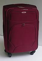 Чемодан дорожный четырехколесный среднего размера текстильный бордовый 58х39х24 см