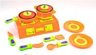 Кухонная плита с посудой для детской игры