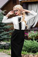 Строгая юбка с длинной ниже колен черного цвета