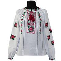 Детская праздничная вышиванка белого цвета расшита цветочным орнаментом крестиком