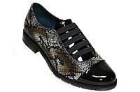 Осенние женские туфли из натуральной кожи '' под питона ''.