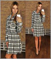 Короткое платье в клеточку с карманами на лифе
