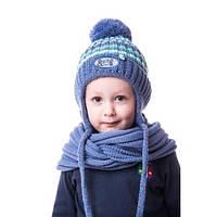 Стильная детская шапочка на мальчика на завязке