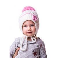 Вязаная детская шапочка на завязках для девочки с цветком