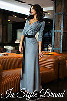 Женское платье в пол с глубоким декольте