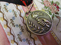 Коллекционеру медаль металл факел 2011 британия