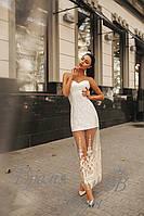 Изысканное молочное платье, сбоку разрез на фатине.