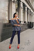 Костюм тёмно-синий, блузка крестьянка с поясом.