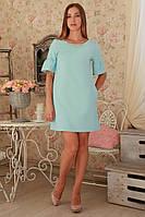 Милое платье с красивым украшением на горловине