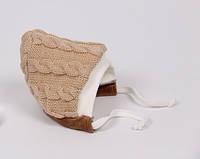 Теплая вязанная шапочка для новорожденного