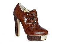 Женские кожаные ботильоны на высоком каблуке и металлической пластине на платформе