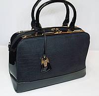 Стильная женская замшевая сумка Suliya c металлическами вставками черного цвета