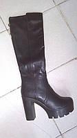 Женские весенние сапоги на высоком каблуке.