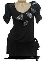 Красивое женское платье-туника с расклешенным низо