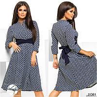 Женское платье с расклешенной юбкой и поясом