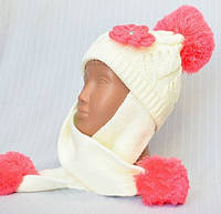 Красивая вязаная шапка-ушанка