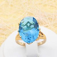R1-0785 - Роскошный позолоченный перстень с ярко-голубым овальным фианитом, 17, 18.5 р.