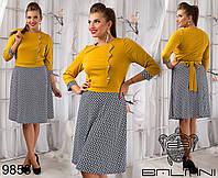 Оригинальное двухцветное платье приталенного силуэта,декорировано пуговицами и поясом.