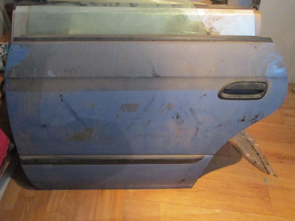 Дверь задняя левая Subaru Legacy 98-04 стекло