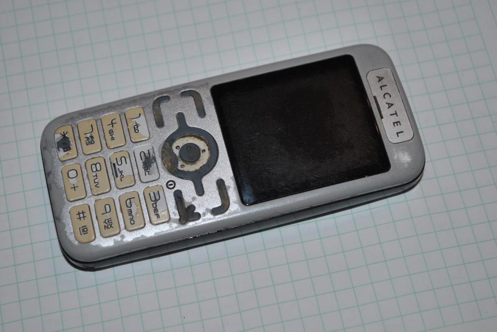Alcatel OT-S218 залочен под оператора