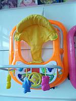 Ходунки детские оранжевые с рулем музыкальные