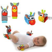 Детские игрушки-погремушки (носочки и браслеты)