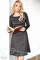 Модное женское платье в мелкую клетку приталенного фасона с длинным рукавом трикотаж