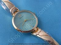 Женские часы Calvin Klein B54 114391 диаметр 3 см золото с бирюзой циферблат без цифр металлический браслет