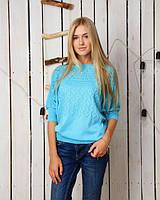 Яркая женская кофта из мелкой вязки голубого цвета