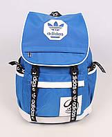 Оригинальный голубой рюкзак с контрастным декором