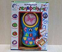 Музыкальная игрушка телефон в коробке