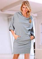 Стильное короткое трикотажное платье с карманами