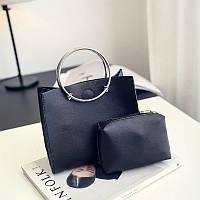 Маленькая женская сумка с круглыми металлическими ручками черная