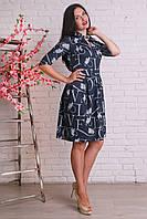 Элегантное платье из ангоры оригинального кроя с красивой брошью