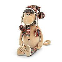 Мягкая игрушка «Orange» (5001/25) обезьянка Ирма в альпийской шапке, шарфе и гетрах, 40 см
