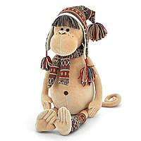 Мягкая игрушка «Orange» (5001/35SK) обезьянка Ирма в альпийской шапке, шарфе и гетрах, 55 см